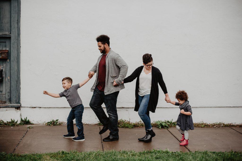 Family of four walk the street