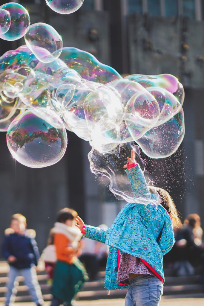 girl-playing-with-bubbles