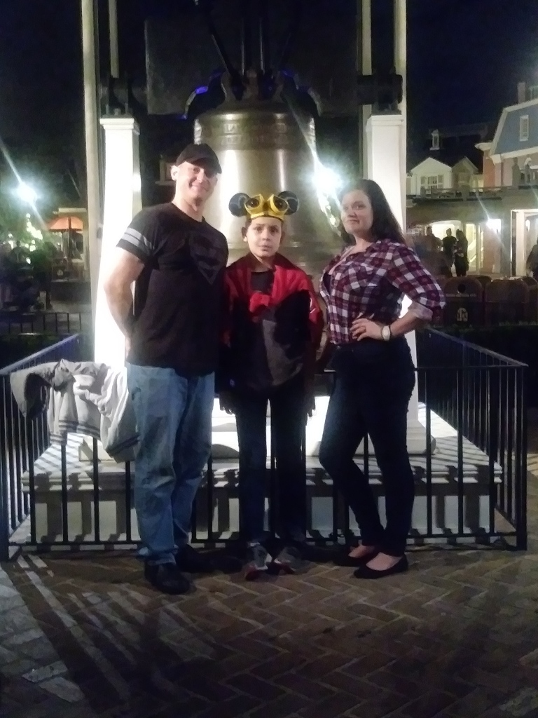 May family around the Liberty Bell in Disney World.